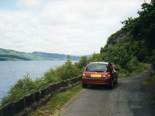 Rental car on rural road Scotland
