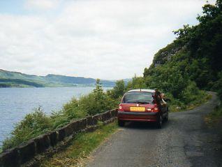 Rental car on rural road Scotland