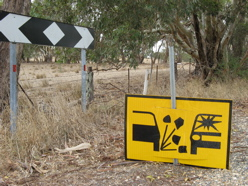 Caution on dirt roads - Australia roadsigns