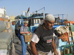 Mark and new friends load Dhow Dubai Creek