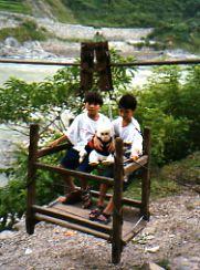 The Monkey riding a  kiri kiri over the Trishuli River with school kids