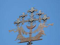 Metal cross at ancient hill in Kernave