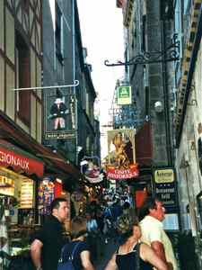 The main street of Mont Saint Michel is crowded with tourists