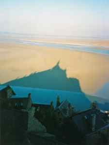 Mont Saint Michel sits on an island with a view, and is surrounded by mudflats