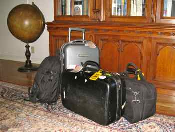 Carry-on luggage sits on a carpet we shipped home