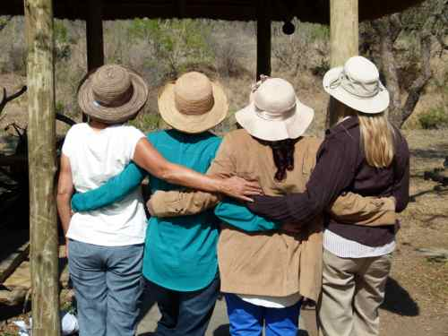 A bunch of tourist and safari hats