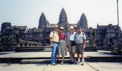 Typical tourist pose on our custom tour to Angkor Wat, Cambodia