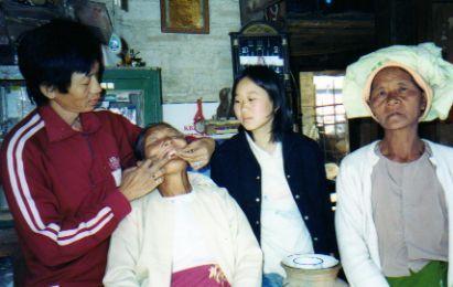 Dentist treating a patient in Pindaya Myanmar (Burma)
