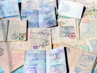 Visas stamped in a passport