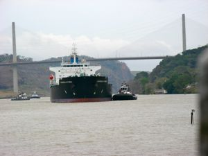 Watch tugs line up the container ships on the Panama Canal