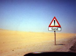 International road signs-Caution Sand in Namib Desert