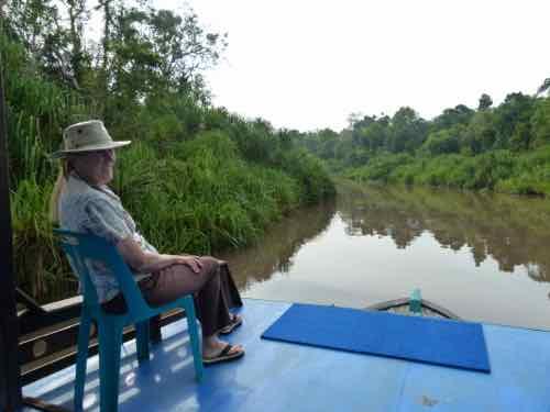 Klotok Boat looking for Orangutans in Borneo