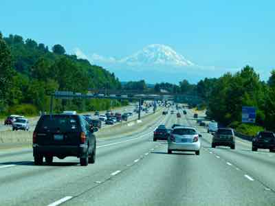 See Mount Rainier from a US HIghway in Seattle