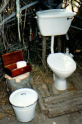Yes, flush toilets in African bush camps