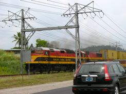 The train runs right along the road at Pedro Miguel Locks